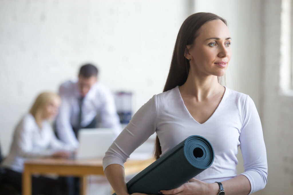 Woman going to office yoga class