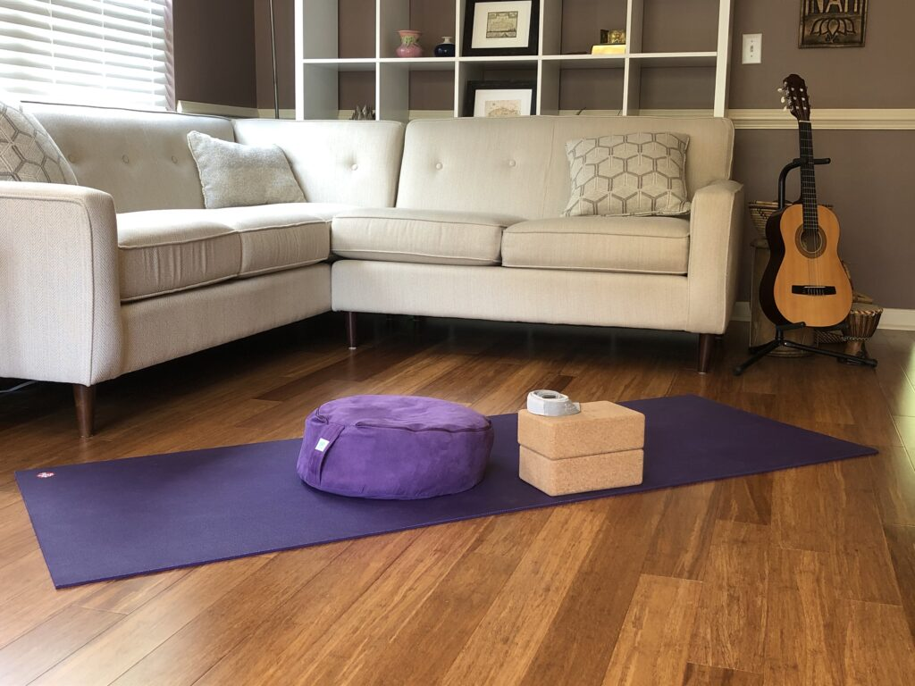 Yoga mat and props set up for private in home yoga class